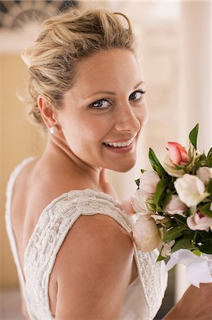 Smiling bride with bouquet Stock Photo - Premium Royalty-Free, Code: 635-07521985