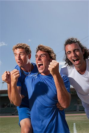 Soccer players cheering Stock Photo - Premium Royalty-Free, Code: 635-07521983