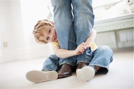 Son hugging grandfather's legs Stock Photo - Premium Royalty-Free, Code: 635-07595954
