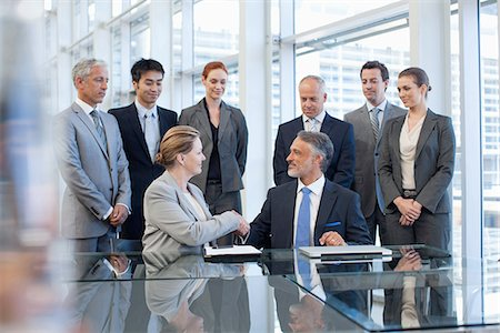 Business people shaking hands in conference room Stock Photo - Premium Royalty-Free, Code: 635-07670728