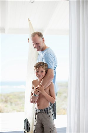 Father hugging son Stock Photo - Premium Royalty-Free, Code: 635-07670853