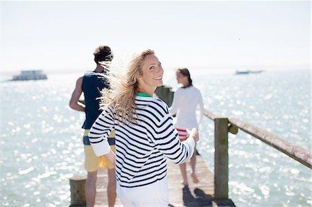 Friends on pier Stock Photo - Premium Royalty-Free, Code: 635-07670941