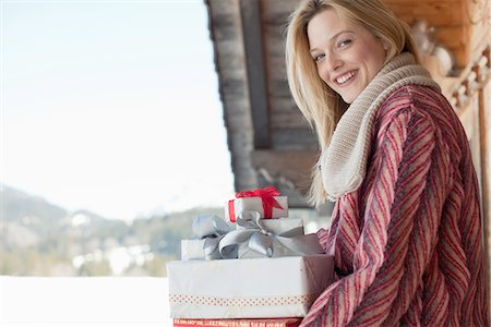Portrait of smiling woman with Christmas gifts Stock Photo - Premium Royalty-Free, Code: 635-07762740