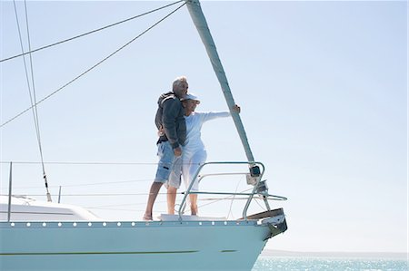 Mature couple hugging on deck of sailboat Stock Photo - Premium Royalty-Free, Code: 635-07762894