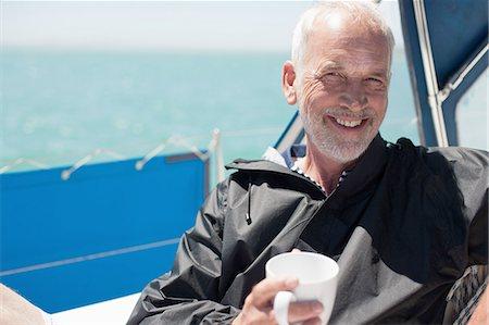 sailboat  ocean - Mature man on sailboat Stock Photo - Premium Royalty-Free, Code: 635-07762901