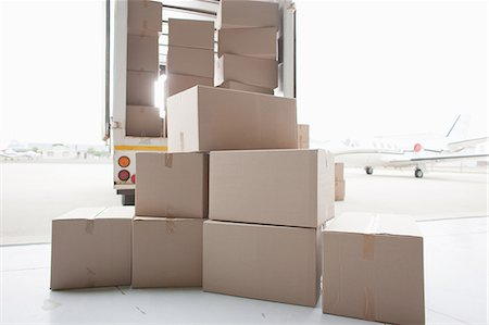 piles of work - Boxes waiting to be loaded onto truck Stock Photo - Premium Royalty-Free, Code: 635-07763002