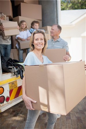 Family carrying boxes from moving van Stock Photo - Premium Royalty-Free, Code: 635-07763016
