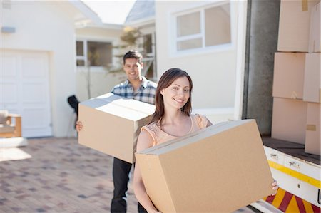 Couple carrying boxes from moving van Stock Photo - Premium Royalty-Free, Code: 635-07763031