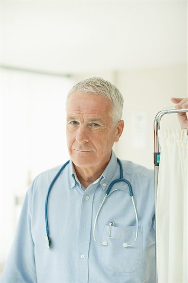 Senior doctor standing in doctor's office Stock Photo - Premium Royalty-Free, Image code: 635-07763133