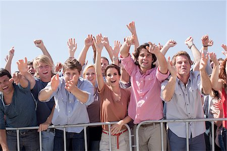 Cheering crowd with arms raised Stock Photo - Premium Royalty-Free, Code: 635-08521985