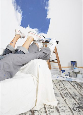 Man and woman waist down on sofa with paint Stock Photo - Premium Royalty-Free, Code: 635-01346480