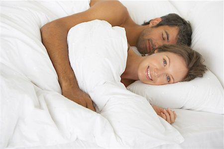 Woman and man lying down in bed Stock Photo - Premium Royalty-Free, Code: 635-01346608