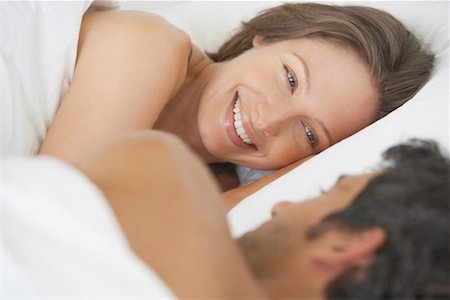 Woman and man lying down in bed Stock Photo - Premium Royalty-Free, Code: 635-01347395