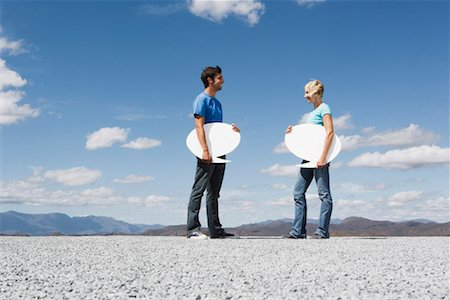 Man and woman outdoors with blank signs Stock Photo - Premium Royalty-Free, Code: 635-01347710
