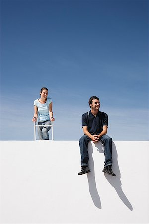Man and woman on wall outdoors with ladder Stock Photo - Premium Royalty-Free, Code: 635-01489522