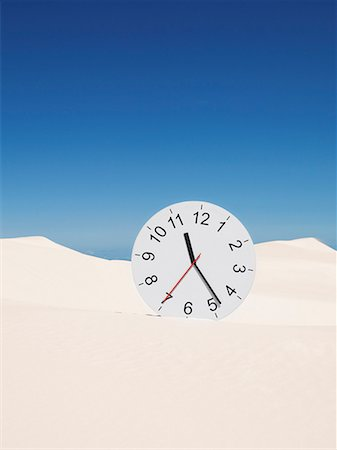 sand clock - An oversized clock in the middle of a desert Stock Photo - Premium Royalty-Free, Code: 635-01594499