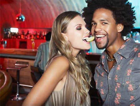 A couple flirting at a bar Stock Photo - Premium Royalty-Free, Code: 635-01594628