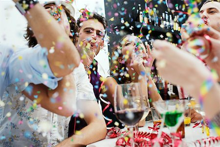 Friends at a party with confetti Stock Photo - Premium Royalty-Free, Code: 635-01707592