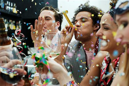 Friends at a party with confetti Stock Photo - Premium Royalty-Free, Code: 635-01707593