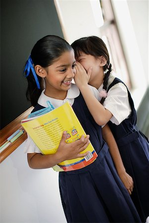 photo of class with misbehaving kids - Two girls whispering in classroom Stock Photo - Premium Royalty-Free, Code: 635-01707657