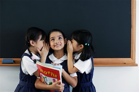 photo of class with misbehaving kids - Three girls in classroom whispering Stock Photo - Premium Royalty-Free, Code: 635-01707658