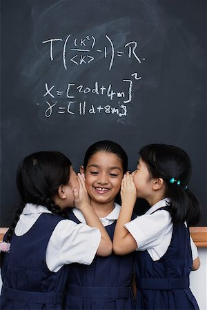 photo of class with misbehaving kids - Three girls in classroom whispering Stock Photo - Premium Royalty-Free, Code: 635-01707664