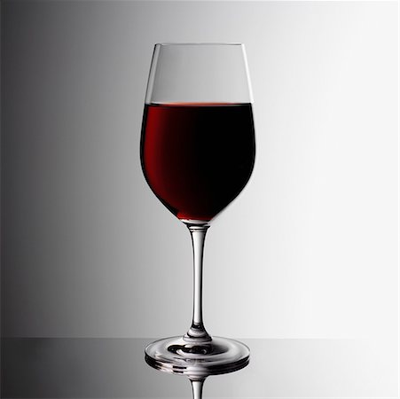 Glass of red wine indoors Stock Photo - Premium Royalty-Free, Code: 635-01824367