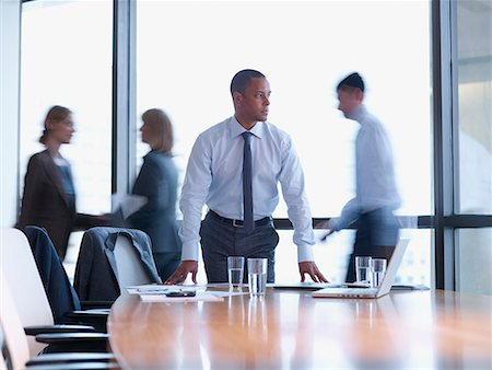 settlement - Businessman in boardroom with three co-workers behind him Stock Photo - Premium Royalty-Free, Code: 635-01824400