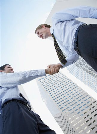 settlement - Two businessmen outdoors shaking hands Stock Photo - Premium Royalty-Free, Code: 635-01824598
