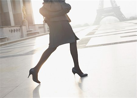 Businesswoman outdoors running through plaza by the Eiffel Tower Stock Photo - Premium Royalty-Free, Code: 635-01824789