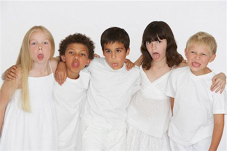 Five young children indoors sticking tongues out at camera Stock Photo - Premium Royalty-Free, Code: 635-01825207
