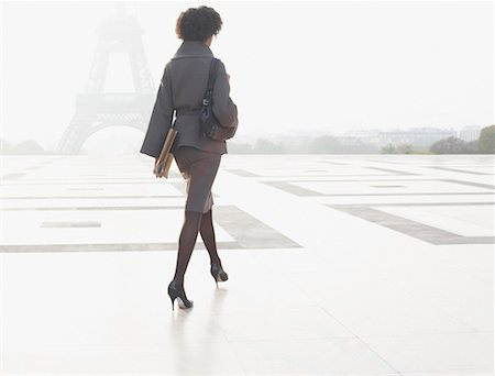 Businesswoman walking through plaza near Eiffel Tower Stock Photo - Premium Royalty-Free, Code: 635-01823535