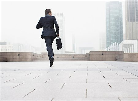 Businessman outdoors jumping Stock Photo - Premium Royalty-Free, Code: 635-01823597