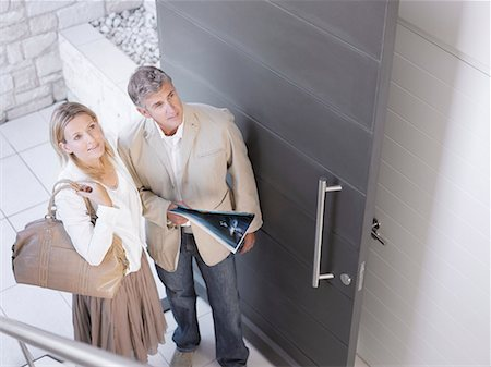 Couple viewing home for sale Stock Photo - Premium Royalty-Free, Code: 635-02152200