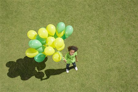release - Young girl holding bunch of balloons Stock Photo - Premium Royalty-Free, Code: 635-02152287