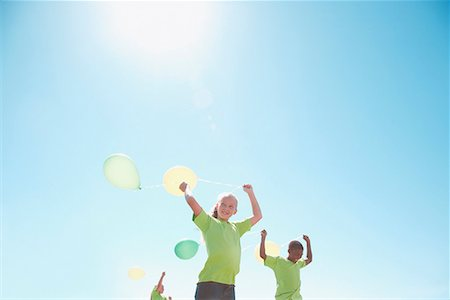 release - Three children holding balloons outdoors Stock Photo - Premium Royalty-Free, Code: 635-02152283