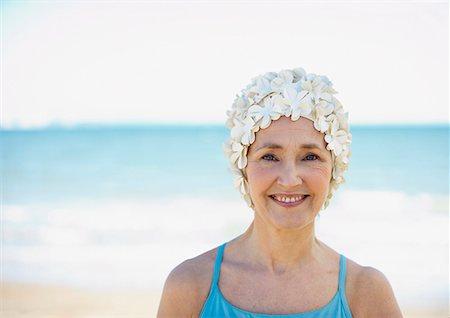 seniors and swim cap - Mature woman in old-fashioned swim cap on beach Stock Photo - Premium Royalty-Free, Code: 635-02152382
