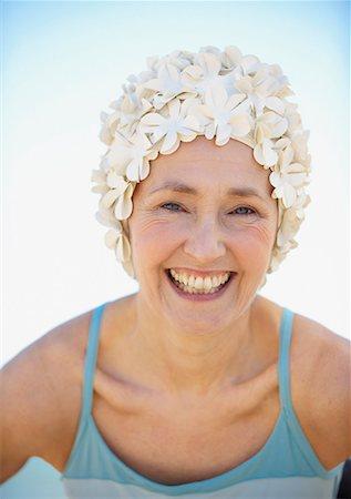 seniors and swim cap - Mature woman in old-fashioned swim cap on beach Stock Photo - Premium Royalty-Free, Code: 635-02152436