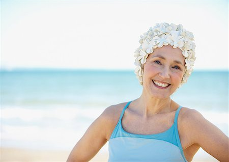 seniors and swim cap - Mature woman in old-fashioned swim cap on beach Stock Photo - Premium Royalty-Free, Code: 635-02152437