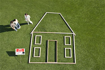 """sold sign - People standing near """"for sale"""" sign and house outline Stock Photo - Premium Royalty-Free, Code: 635-02218638"""