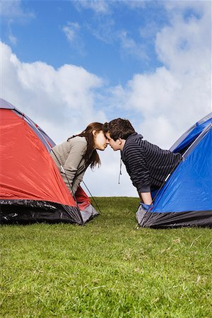 Couple kissing in tents Stock Photo - Premium Royalty-Free, Code: 635-02218967