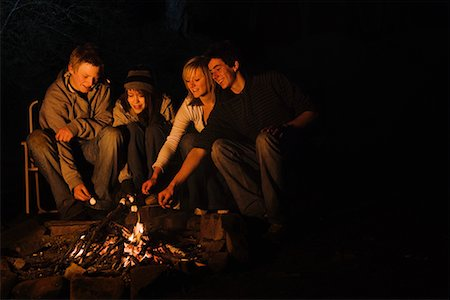 preteen girl boyfriends - Teenage couples roasting marshmallows over campfire Stock Photo - Premium Royalty-Free, Code: 635-02218992