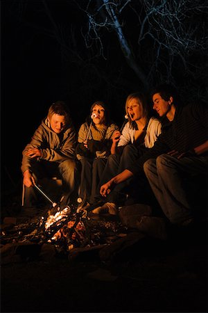 preteen girl boyfriends - Teenage couples roasting marshmallows over campfire Stock Photo - Premium Royalty-Free, Code: 635-02218993