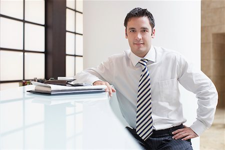 european cafe bar - Businessman sitting at counter in cafe Stock Photo - Premium Royalty-Free, Code: 635-02219085