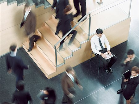Businessman working in busy office corridor Stock Photo - Premium Royalty-Free, Code: 635-02312535
