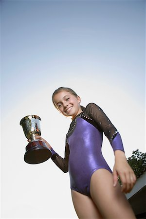 preteen girls gymnastics - Young gymnast holding trophy Stock Photo - Premium Royalty-Free, Code: 635-02312890