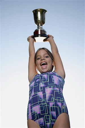 preteen girls gymnastics - Young gymnast holding trophy Stock Photo - Premium Royalty-Free, Code: 635-02312892
