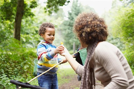 Mother and son exploring park Stock Photo - Premium Royalty-Free, Code: 635-02614299