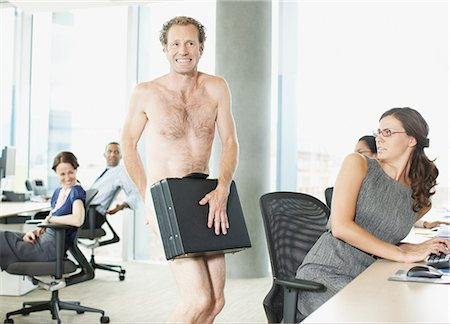 Naked businessman with briefcase in office Stock Photo - Premium Royalty-Free, Code: 635-02614467
