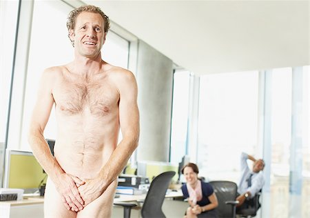 Naked businessman in office Stock Photo - Premium Royalty-Free, Code: 635-02614468